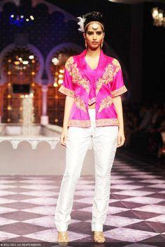 Miss India World '10 Manasvi Mamgai flaunts a creation by designer Raghavendra Rathore on Day 3 of the India Bridal Fashion Week (IBFW) 2013 at The Grand, Vasant Kunj in New Delhi.