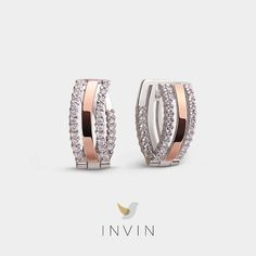 NEVA EARRINGS Sleek Classic: Silver and 9kt. Rose Gold Earrings with Cubic Zirconia. The chic rose gold arches of these earrings evoke the many bridges that rise over the River Neva in St Petersburg. Imagine yourself by the river's edge on a hot summer night, these elegant earrings dangling from your ears. Rhodium plated silver and cubic zirconia make this ring a cool, sleek classic. Rose Gold Earrings, Dangle Earrings, Over The River, The Chic, Arches, Bridges, Silver Plate, Ears, Dangles