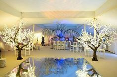 LED Trees in a Marquee, stunning for weddings or Events. www.bubblespace.uk.com