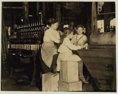 """Date: June 1910  Location: Seaford, Delaware.  The photo shows Daisy Langford, an 8-year-old who works at Ross' canneries. She helps at the capping machine, but is not able to """"keep up."""" So she places caps on the cans at the rate of about 40 per minute working full time. That was her first season at the cannery."""