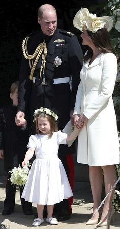 Princess Charlotte smiles as she holds a bouquet of flowers outside the chapel today, with her parents William and Kate