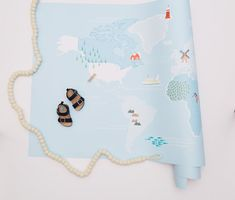 Clean lines and cool colors make this Kids Map from Chasing Paper one of our favorite world map decals.