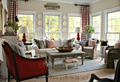 Buffalo check curtsins.  Neutral sofa with mix of fun chairs.  Red lsmps look good with curtains.  Windows of course are wonderful