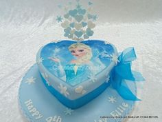 Elegant heart shaped birthday cake with Frozen Elsa image finished with a matching wired topper containing hearts and snow flakes and a tied with a chiffon ribbon and bow Movie Theme Cake, Frozen Theme Cake, Frozen Cupcakes, Frozen Birthday Cake, Frozen Disney, Elsa Frozen, Heart Shaped Birthday Cake, Heart Shaped Cakes, Photo Print Cake