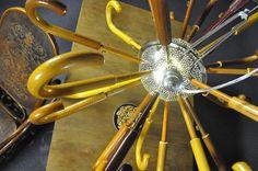Umbrello - chandelier made of kitchen colander and old umbrella handles Chandelier, Kitchen, Cuisine, Cooking, Home Kitchens, Chandeliers, Kitchens, Candelabra, Cucina