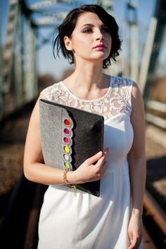 This is a designed and made by me big size felt clutch. It is decorated by colorfull dots. Looks really nice :) Im sure you are going to like it!