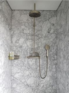 Solid marble shower walls are much easier to clean than subway tiles with grout lines. It also looks luxurious!