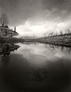 Jerry Uelsmann : Works: The Edge of Silence 2007 Even though this is retouched it exemplifies dividing horizontally into thirds and balance with 2 reflections.