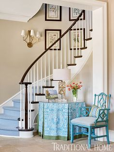 Soft blues welcome in the entry, which offers sightlines to the great room and back yard. - Photo: Emily Jenkins Followill / Design: Carolyn Kendall with Betsy Trabue