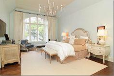 pale blue master bedroom walls, dark hardwood floors