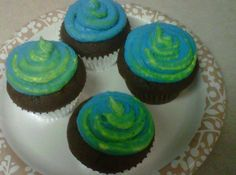 Tye Dye cupcakes! Blue and Lime green....vanilla buttercream on top of a dark chocolate cupcake