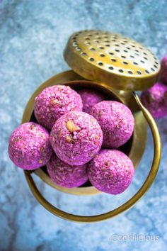 Vegan No Bake Raspberry Energy Bites are made with raw cashews, coconut and raspberries. They\'re brightly flavored and a delicious pick-me-up, healthy snack recipe. They are No Cook, Gluten Free and Vegan Friendly. A tasty and nutritious snack that adults and kids will love equally.