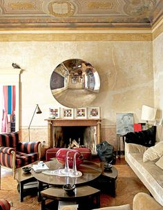 Marble walls in this neutral, earth-toned living space with modern coffee table and glass sculptures // Italian design