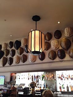 And this is the bar, where we were seated. Don't worry - the turtle shells aren't real, they are made from molds. They look so cool though, and look at the beautiful lamp!