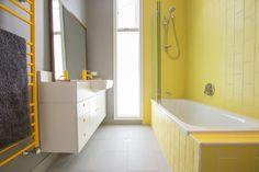 Fun, yellow tiled bathroom