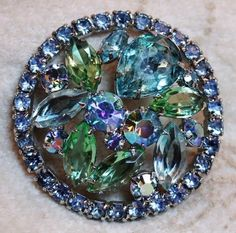 Vintage Weiss Blue Green AB Aurora Borealis Crystal Domed Brooch Pin is an open work domed design set with faceted AB coated crystals.  The crystals are marquis and round shaped and there is one large