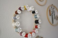 embroidery hoop thread rack    What if you make several in different sizes so you have concentric circles on the wall?  I have way too much thread for one hoop.