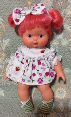 http://www.ebay.com/itm/Vintage-Brazilian-Strawberry-Shortcake-Strawberry-Blow-Kiss-doll-Ooak-Brazil-/181942231763?hash=item2a5c9a22d3:g:kNEAAOSwnipWVdyG