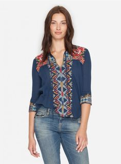 Margo Boho Blouse Inspired by a beautiful, vintage peasant top, the ornate embroidery on the 3J MARGO BOHO BLOUSE is a handiwork stand out. The artisanal geo design in our bold, fall color palette, along with the looser silhouette make this top a true boho beauty.   —Cotton —Signature Embroidery —V neck —Ties at the neck