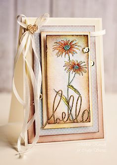 Hello - Scrapbook.com - the long bow ties, gold glitter, distressing and watercoloring make this a stunning, elegant card!