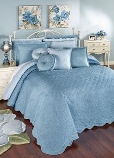 Dream about your happily Everafter as you drift off to sleep beneath this dusty blue, solid color bedspread. Reversible grande bedspread is cotton sateen.