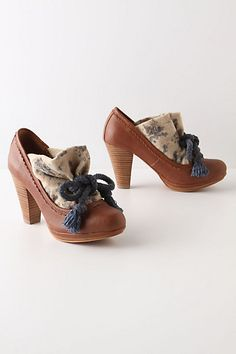 I LOVE these Anthro heels... How about attaching a swatch of fabric and bow to a little sock, and then you can Jazz up all of your heels for a fun Vintage Feel, A night out, etc!
