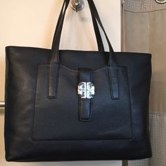 """Tory Burch """"Meyer Plaque Tote"""" in Leather, NWT GORGEOUS Black color pebbled leather. Very spacious inside with 1 large zipper pocket on one side and on the opposite side has 3 large pockets that are large enough to hold an iPhone plus or equal. The top has a zipper closure for added security with all gold hardware. The front pocket has a snap magnetic closure and the back of the bag has a deep slip pocket as well. Measurements:      17"""" L X 11-1/2"""" H X 5"""" D with a 9 inch drop. Tory Burch…"""