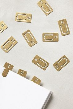 Brass clips: http://www.stylemepretty.com/living/2015/01/06/chic-tid-bits-for-an-organized-year/