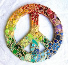 Mosaic Peace Sign    Glass, beads, shards, fimo, flowers, butterflies, jewels, mille, smilies, nuggets, pebbles, shells, leaves, feet, glitter... I put all I had into and onto this!    Grouted in sand colour. Including all the edges which were a pig to do!    On a wonderfully made MDF base from zzbob