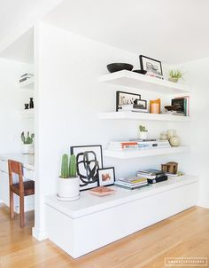 Like the idea of floating shelves. 1) to put above the kitchen table. This shelf will be where the modem/router will sit (since those outlets are high up). 2) To put these on the wall in the living room when you walk in (on your right). Possibly put a long, low table below the shelf/shelves.