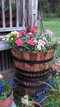 Real Wood 26 in. dia. Cedar Half Whiskey Barrel Planter G3056 at The Home Depot - Mobile Whiskey Barrel Flowers, Half Whiskey Barrels, Whiskey Barrel Planter, Half Barrel Planter Ideas, Wood Barrel Planters, Container Flowers, The Ranch, Raised Garden Beds, Backyard Landscaping
