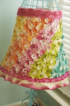 Such a beautiful apron.  Can you imagine the work that must have gone into adding all the flowers?