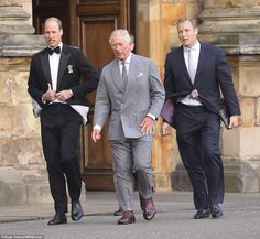 William looked dapper in a black dinner jacket with a silk bow tie while his father opted for a grey pinstriped suit and a pair of burgundy coloured shoes