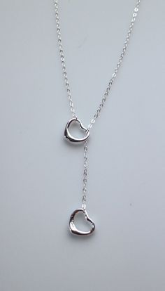 Sterling Silver Double Heart Lariat Necklace by NikolaJewelry