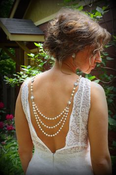 Backdrop Necklace...subtly sexy wedding dress detail