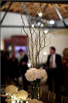 Doing similar centerpieces but with brown willow tree branches, not green. Wrapping the vases in burlap, and tying a twine or copper ribbon bow around them, then sprinkling burn orange flower petals on the table around it! :)