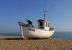 Beached by Steven Murphy - Fishing boat on the beach at Hastings (UK)