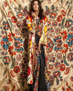 Amazing photo, large Suzani silk embroidered tapestry and Ikat kaftan. Designer Dildora Kasimova.