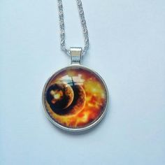 orange cosmic space pendant on a silver chain