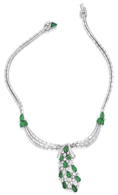 Emerald and Diamond Necklace. Designed as rows of baguette diamonds decorated by pear-shaped emeralds, the centre suspending a pendant of cluster design, set with pear-shaped emeralds, marquise-shaped and brilliant-cut diamonds, completed by a clasp set with a triangular-shaped emerald, mounted in platinum. Sotheby's.
