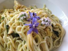 Decorating a simple plate of spaghetti with the beautiful blue borage flowers and white tasty thyme flowers ...