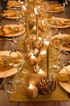 Glittering textured candles, gold ornaments and succulents-turned glamorous candle holders line the center of the dining table. minus the long candles, add some colour and foliage Christmas Table Settings, Christmas Tablescapes, Christmas Table Decorations, Decoration Table, Wedding Decorations, Holiday Decor, Holiday Tablescape, Wedding Favors, Tree Decorations