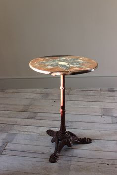 An Stylish 1960s Occasional Cast Metal Table With A Composition Top Inset  With An Ammonite.