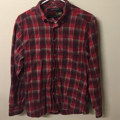 Size small vintage flannel Old navy vintage flannel. Size small but kinda big so good for medium. Has the colors red brown and white in it. Old Navy Tops Button Down Shirts