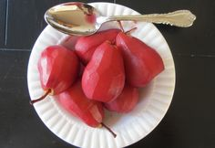 Pears, simply poached in red wine with citrus juice & zest.