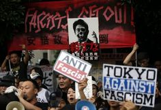 Japan takes historic step from post-war pacifism, OKs fighting for allies - REUTERS UK #Japan, #PostWarPacifism
