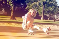 Women doing tricks on some rollerblades having the best of times.
