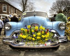 Love the daffodils on the old car.