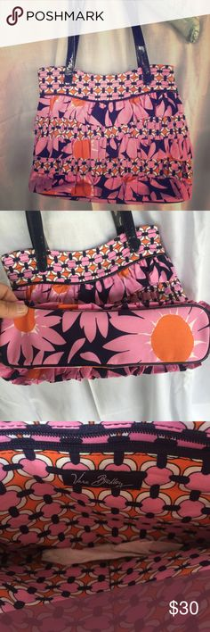 Vera Bradley Bag 🌞 Super cute, super casual, fun lil Vera Bradley ruffle bag with patent handles.  Seriously, like new condition. Orange, navy, pink & white. Navy handles. Navy patent piping. Inside has 1 zip pocket & 2 other pockets.  Bottom from side to side is 11 inches, depth is 8.5 inches, height is 9 inches & strap drop just shy of 9 inches. This is too sweet to pass up. Offers welcome. Sorry, I do not trade~ Vera Bradley Bags Mini Bags