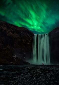 "Amazing shot captured travelling of Waterfall with the Northern Lights in the background named- ""Falling Down by Javier de la Torre"""